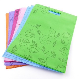 38345-02 PACK OF 12 NON WOVEN 25 X 33 CM PRINTED BAGS IN ASSORTED COLOURS