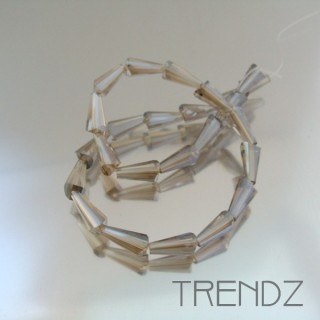 18708-15 STRING OF 25 FACETED GLASS 6 X 12 MM CONE BEADS